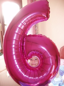 Rebekah with her '6' balloon for her birthday